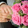 Wedding Bouquet with hands and rings — Stock Photo