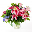 Bouquet of flowers in glass vase — Stock Photo