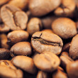 Brown coffee beans as background and texture — Stock Photo