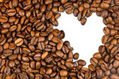 Roasted coffee beans and the shape of the heart. — Stock Photo