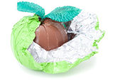 Brown chocolate apple shape in foil isolated — Stock Photo