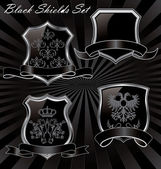 Black shields — Stock Vector