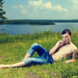 Young man lying on meadow — Stock Photo