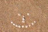 Smile sign on the beach — Stock Photo