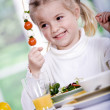 Young girl eating salad at home. A studio shoot — Stock Photo #6098595