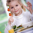 Young girl eating salad at home. A studio shoot — Stock Photo #6098596