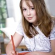 Stock Photo: Drawing schoolgirl