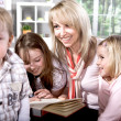 Family at reading in the flat — Stock Photo