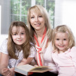 Family at reading in the flat — Stock Photo #6098651
