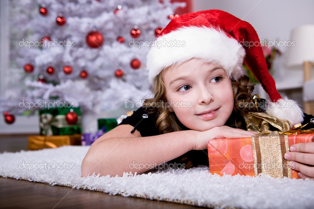 A little girl geting the Christmas gift  Stock Photo #6098527