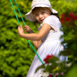 A closeup portrait of a young girl on a swing - Stock Photo
