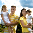 A closeup summer portrait of a happy family — Stock Photo