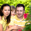 A closeup summer portrait of a happy family - Stock Photo