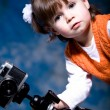 Little girl with camera — Stockfoto