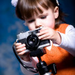 Little girl with camera — Foto de Stock