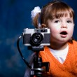 Little girl with camera — Stock Photo