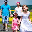 Family in the field — Stock Photo #6100592