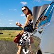 Woman hitch-hiking — Stock Photo