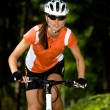 Stock Photo: Cycling woman