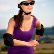 Young woman on rollerblades in the country — Stock Photo #6101604
