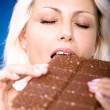 Woman with bar of chocolate — Stock Photo #6108397