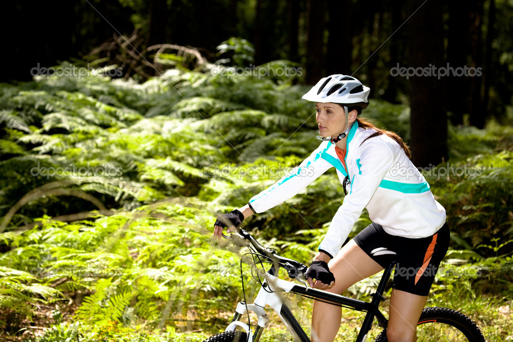 A cycling woman in front of forest — Stock Photo #6101593