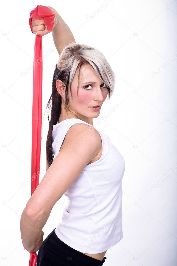 Young woman with rubber strap — Stock Photo #6108916