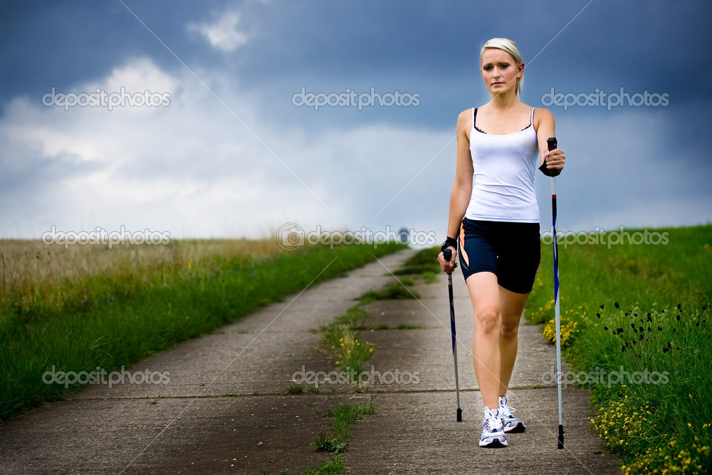 A young woman making nordic walking. outdoor shoot. — Stock Photo #6108947
