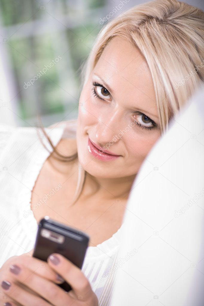 Young woman with a mobile phone — Stock Photo #6108985