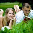 Reading young couple — Stock Photo