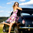 Girl and a vintage car — Stock Photo