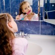 Stock Photo: Girl brushing teeth