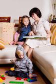 Reading family — Stock Photo