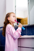 Girl brushing teeth — Stock Photo