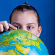 Stock Photo: Girl with globe