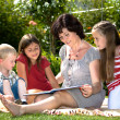 Reading in garden - Stock Photo