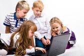 Children with laptop — Stock Photo