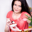 Woman with yogurt bowl — Stock Photo