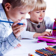 Two drawing kids - Stock Photo