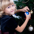 Decorating of Christmas tree - Stock Photo