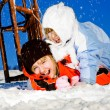 Foto Stock: Girls crashing at sledding