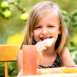 Eating girl — Stockfoto