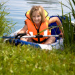 Stockfoto: Young girl at a lake