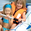 Two young girls at a lake — Stock Photo #6218811