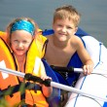 Young girl and boy at a lake — Stock Photo #6218816