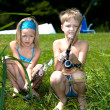 Young girl and boy fishing — Stockfoto