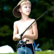 Stock Photo: Young boy fishing at a lake