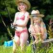 Two young girls fishing at the lake — Stock Photo #6218827