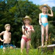 Children fishing at the lake — Stock Photo #6218829