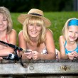 Family fishing at the lake — Stock Photo
